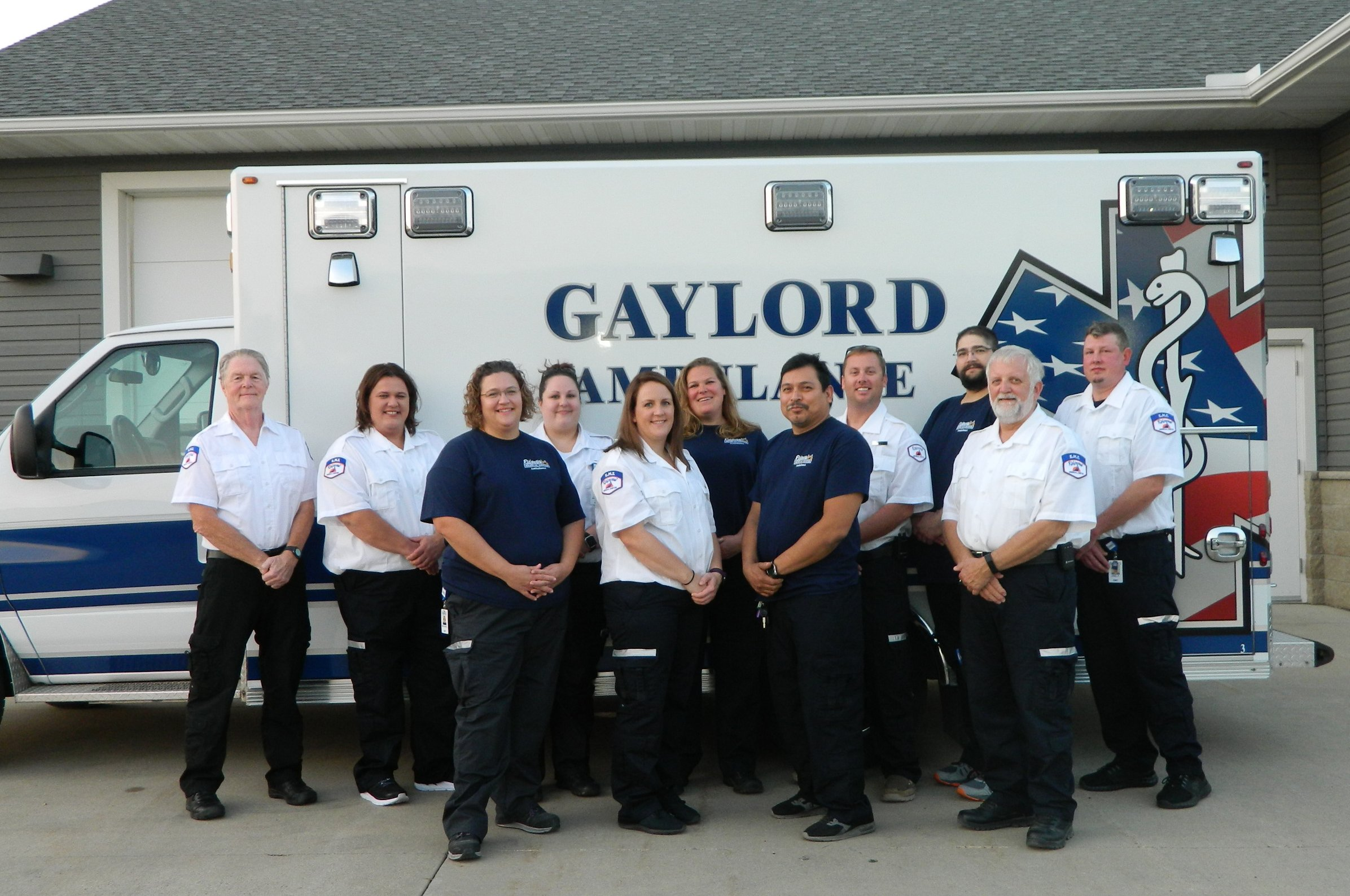 Photo of Gaylord Ridgeview Ambulance Staff standing in front of an ambulance